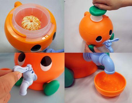[使用方法] 頭のフタを開けてみかんを投入→フタを閉めみかんのハンドルを回す→蛇口をひねる→ジュースが出る、という流れ