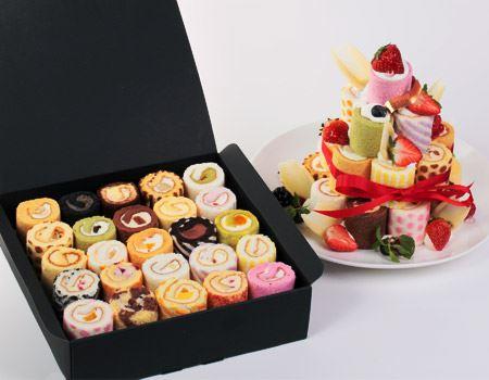 ロールケーキを積み上げてデコレーションケーキ風にした「ロールケーキタワー」