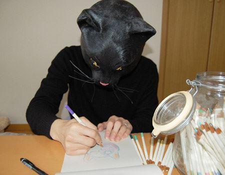 お絵描きする猫……