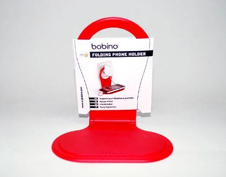 「bobino FOLDING PHONE HOLDER」。赤のほか、カラーバリエーションは黒、白、青、緑、ピンクがあります