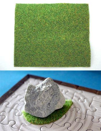 苔マットは任意に切り取って使います。苔マットの上に石を配置してみました