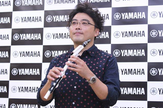 サキソフォン奏者の福井さん。「どこへでも手軽に持ち運んで楽しめるのがイイ」とVenovaの魅力を語った
