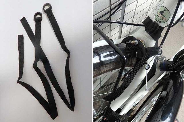 畳んだ自転車が開いてこないようにするために、2本の固定ベルトが付属します