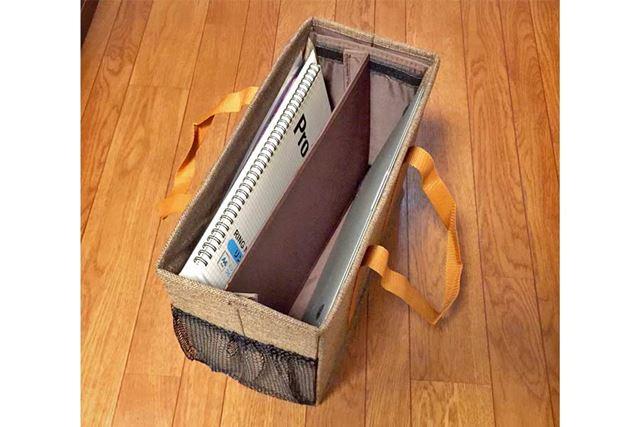 仕切り板を真ん中に付けたところ。バッグだけど収納ボックスのように使える口の広さ