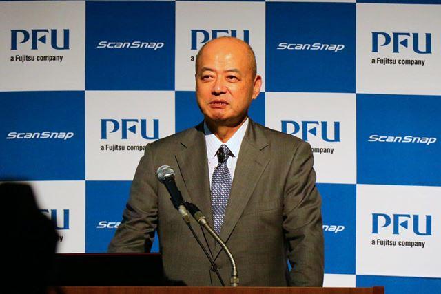 PFUの半田清社長。iX1500を「誰でも使える家電のような使いやすさを目指した」と説明