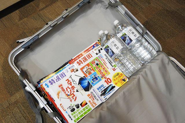 ペットボトル4本+古雑誌+スーツケースで合計32kgになるようにした