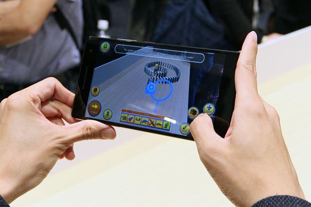 ドミノのゲームアプリ。画面上の机の上にドミノを並べて倒せる